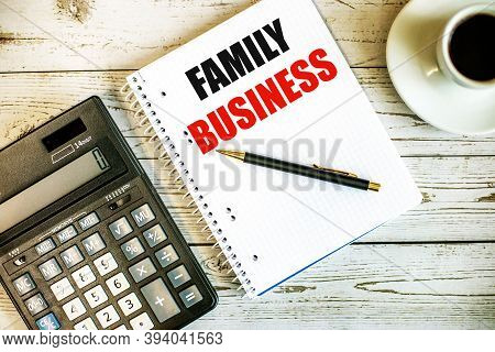 Family Business Written On White Paper Near Coffee And Calculator On A Light Wooden Table. Business