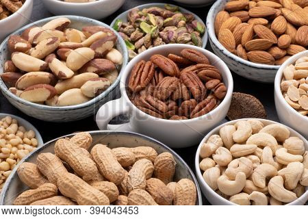 Assortment of various nuts in bowls and cups