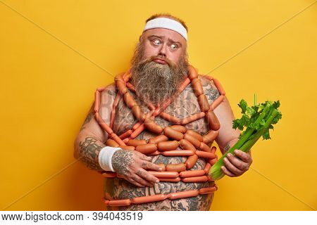 Puzzled Bearded Stout Man Chooses Celery Instead Of Sausages, Controls What He Eats, Has Healthy Pro