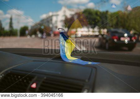 Flag Of European Union And Ukraine Inside The Car. Flags Of European Union And Ukraine Together Rend