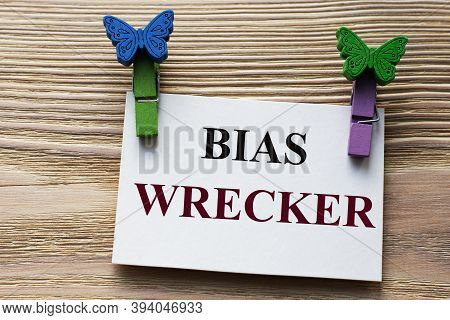 Bias Wrecker - Word On A White Sheet With Beautiful Clothespins On A Wooden Background. Business Con