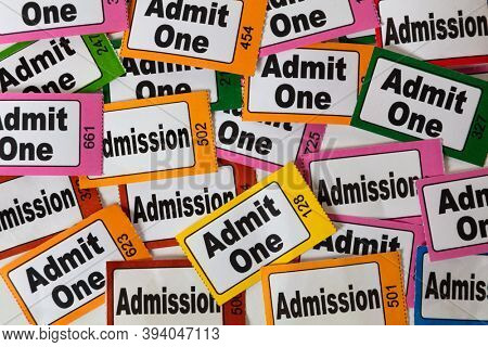 Close up of colourful multi-coloured traditional admission admit one tickets