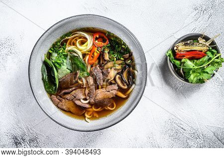Pho Bo Vietnamese Soup With Beef. White Background. Top View