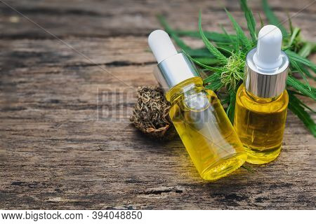 Cannabis Herb And Leaves With Oil Extracts In Jars. Medical Concept, Marijuana Cbd Oil Hemp Products