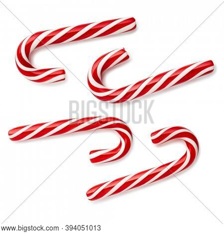 Candy cane - Christmastide and Saint Nicholas Day tradition treat. Set of sweets on a white background. Flat lay, top view
