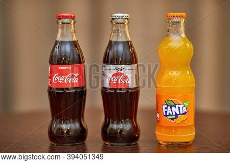 BUDAPEST, HUNGARY - CIRCA 2019: Bottles of Coca-Cola and Fanta soft drinks on a table, Light and Original, poducts of Coca-Cola Company