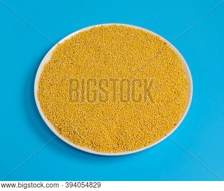 millet groats in white plate