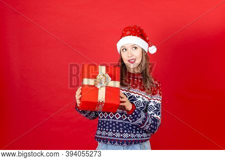 In Anticipation Woman With Box In Hand Want To Find Out Whats Inside In Sweater Christmas Print And