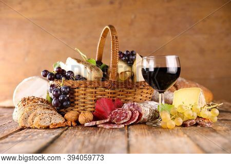 red wine glass with cheese and salami