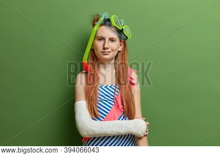 Discontent Redhead Girl Wears Snorkeling Mask, Enjoys Water Sport And Outdoor Adventures, Ready For