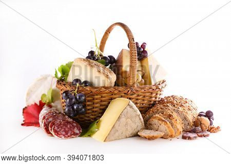 wicker basket with cheese and salami