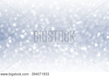 Abstract Blurred Fancy Silver And White Glitter Sparkle Confetti With Gradient Light Reflect For Bac