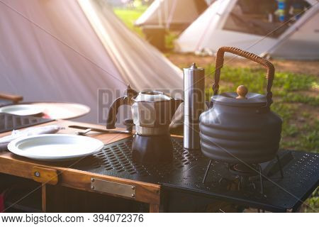 Vintage Outdoor Black Kettle, Coffee Grinder And Outdoor Kitchen Equipment On Camping Table With Mor