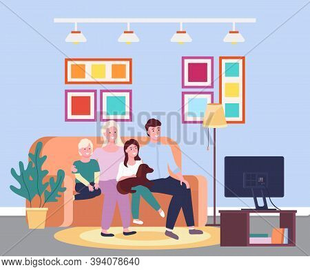 Family Evening At The Tv. Four Member Family Together Smiling Sitting Io The Sofa In Front Of The Te