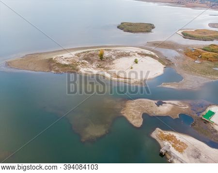 Scenic Aerial Drone Birds Eye View Of Swallow Sand River Or Lake Shore Due To Drought And Water Pond