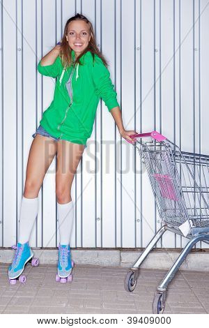 a beautiful young girl in roller scates near supermarket trolley