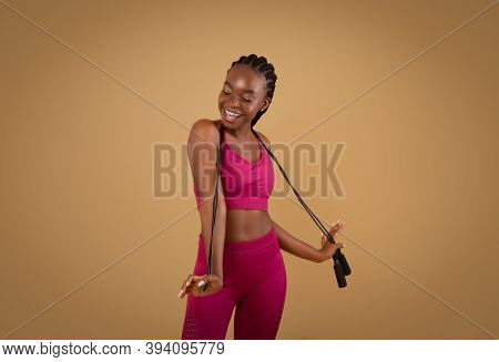 Fitness Concept. Portrait Of Joyful Fit Black Lady Posing With Jump Rope, Young Positive African Ame