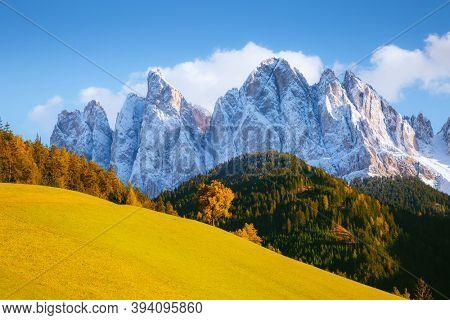 Splendid landscape in St. Magdalena or Santa Maddalena village. Location place Val di Funes (Villnob), Dolomite alps, Trentino-Alto Adige, Italy, Europe. Discover the beauty of earth.