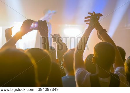 People Hands Silhouette Taking Photo Or Recording Video Of Live Music Concert With Smartphone. Crowd