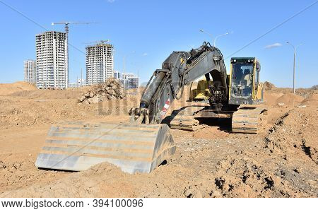 Excavator With Grading Bucket Ditching Bucket For Leveling And Cleaning Works. Backhoe During Earth-