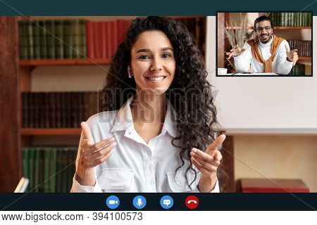 Remote Distant Communication Concept. Woman In Earphones Having Video Conference With Her Indian Col