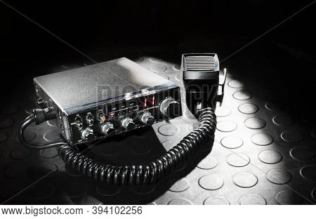 Two-way Radio With Microphone On A Dark Background And Rubber Mat