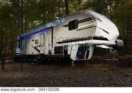 Fifth Wheel Camper In Early Fall At North Carolina's Falls Lake