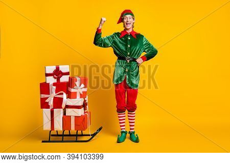 Full Length Body Size View Of His He Nice Attractive Cheerful Cheery Funny Guy Elf Carrying Gifts On