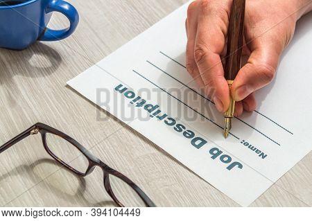 Person Fills Out A Job Description Form Before Looking For Good Job
