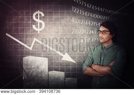 Upset Businessman Looking Focused To A Decreasing Financial Graph. Man Analyst Gives Negative Econom