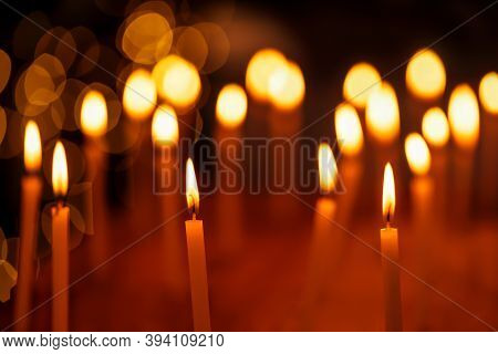 Beautiful Group Of Candles Lit During Diwali Festival Night With Light Bokeh Background. Concept For