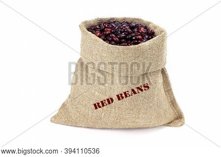 A Sack Of Red Kidney Beans Isolated On A White Background. Haricot Beans In Burlap Saks. Kidney Bean