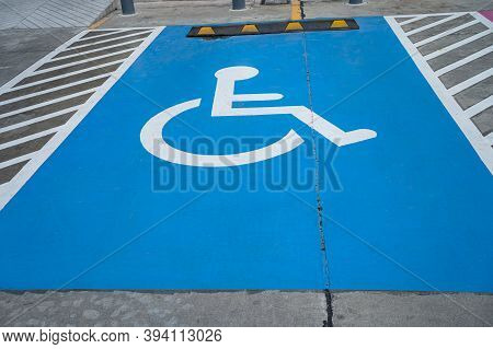 Blue Handicap At Parking Car Sign Outdoors For Disabled, Wheelchair Or Elder Old Or Cannot Self Help