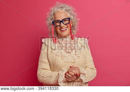 Horizontal Shot Of Positive Adorable Old Lady Smiles Friendly At Camera, Has Happy Mood After Visiti