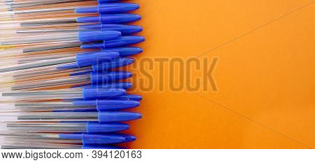 Ballpoint Pens For Writing On A Brown Background. View From Above. Handles Of The Case Are White, Th