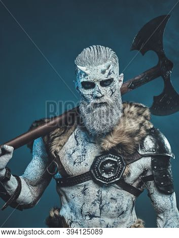 Pale Skinned Winter Undead Warrior With Horns And White Hairs Holding Two Handed Axe On His Shoulder
