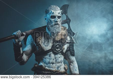 Nordic And Mystical Fashion Undead Dressed In Dark Armour With White Hairs And Skin Holding Two Hand