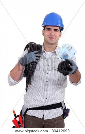 Electrician holding piggy-bank