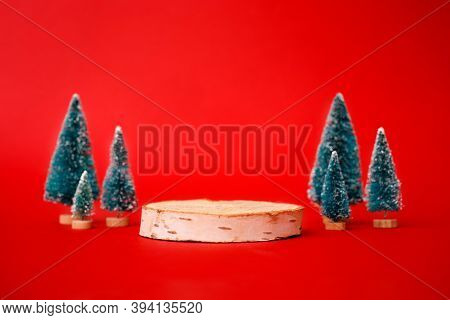 Mock Up With Wooden Podium From A Circle Of Wood On Trendy Red Background With Christmas Decoration