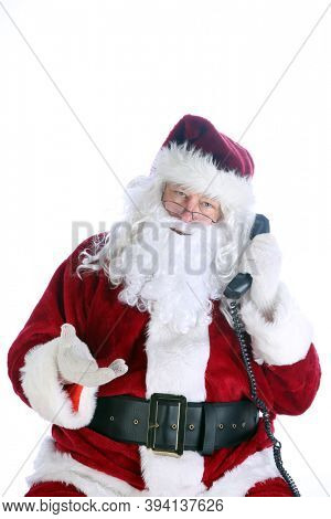 Santa Claus Phone Call. Santa talks to someone on his telephone before Christmas. Isolated on white. Room for text. Call Santa this Holiday and tell him what you would like.