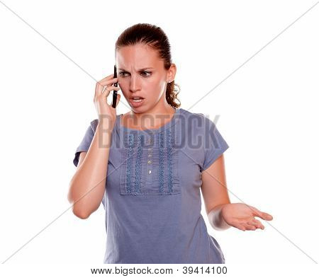 Surprised And Angry Woman Speaking On Cellphone