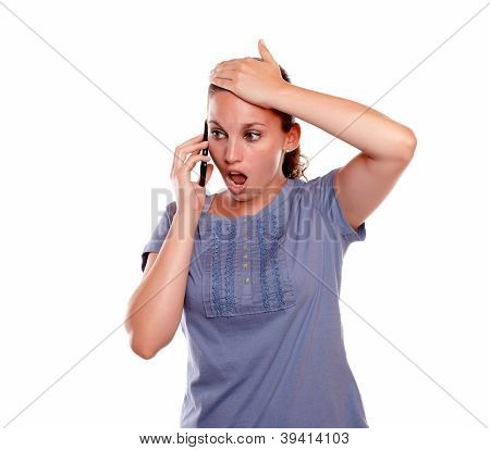 Surprised Young Female Speaking On Mobile Phone
