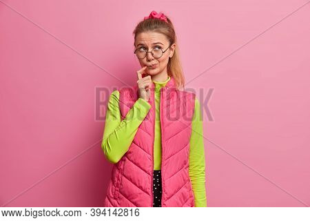Thoughtful European Teenage Girl Ponders Over Idea, Faces Dilemma, Looks Uncertain And Doubtful, Wea