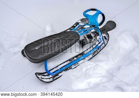 A Sledge Is In The Snow, A Close-up. A Winter Snowmobile