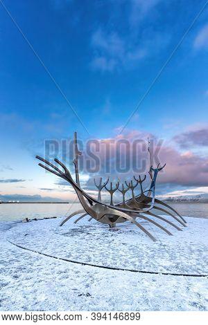 Reykjavik, Iceland. - 17 January 2020: The Sun Voyager, a modern sculpture by Jon Gunnar Arnason, of a viking ship. Sunset in Reykjavik, Iceland.