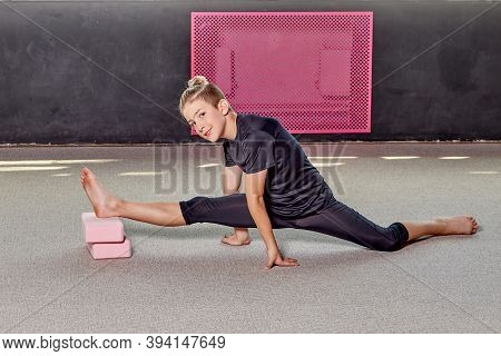 A Young Man Trains Flexibility And Endurance, Look In The Frame.