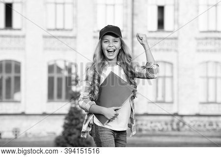 Happy Preschool Girl With Folder In School Yard. Back To School. Hardworking Child With Book. Concep