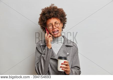 Displeased Crying Adult Woman Complains About Much Work, Has Nervous Breakdown And Talks Via Smartph