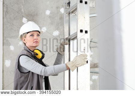 Woman Construction Worker Builder Portrait Wearing White Helmet And Hearing Protection Headphones, H