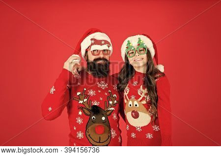 Magic Moment. Little Girl And Dad Santa Hat. Bearded Daddy And Kid Red Background. Christmas Party T